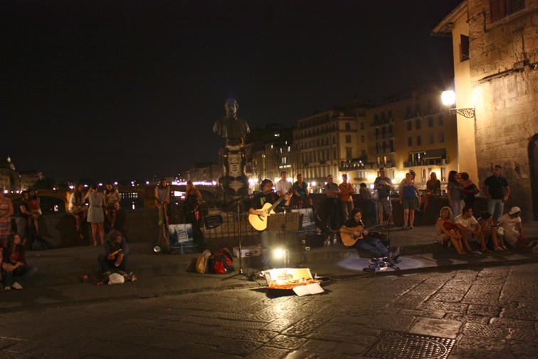 Entertainment on the Bridge- The Ponte Vecchio was crowded in the evening as people wound down from the day with a view of the river and guy on guitar.